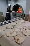 Israel, Bnei Brak. Passover at the Premishlan congregation, the Motzot &#xA;Baking on Passover eve, the Rabbi by the oven, 2005<br />