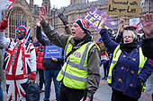 Brexit supporters demonstrate outside the Houses of Parliament as MPs vote on amendments to Theresa May's withdrawal deal with the EU.  Westminster, London.
