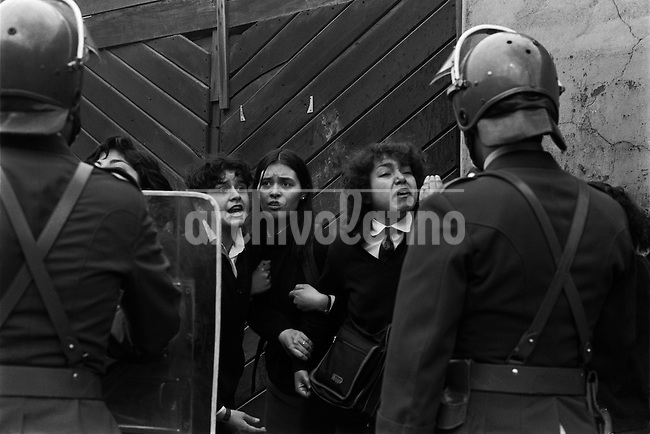 Toma y desalojo del liceo ni&radic;&plusmn;as N&not;&int; 4 de Santiago ocupado por las alumnas para protestar por la municipalizaci&radic;&ge;n de la educaci&radic;&ge;n.<br /> SANTIAGO CHILE 25 Septiembre 1985<br /> <br /> Forty years ago, on September 11, 1973, a military coup led by General Augusto Pinochet toppled the democratic socialist government of Chile. President Salvador Allende was killed during the  attack to seize  La Moneda presidential palace.  In the aftermath of the coup, a quarter of a million people were detained for their political beliefs, 3000 were killed or disappeared and many thousands were tortured.<br /> Some years later in 1981, while Pinochet ruled Chile with iron fist, a young photographer called Juan Carlos Caceres started to freelance in the streets of Santiago and the poblaciones or poor outskirts, showing the growing resistance against the dictatorship. For the next 10 years Caceres photographed every single protest and social movement fighting for the restoration of democracy. He knew that his camera was his only weapon, he knew that his fate was to register the daily violence and leave his images for the History.<br /> In this days Caceres is working to rescue and organize his collection of images in the project Imagenes de la Resistencia   . With support of some Chilean official institutions, thousands of negatives are digitalized and organized to set up the more complete visual heritage of this  violent period of Chile&acute;s history.