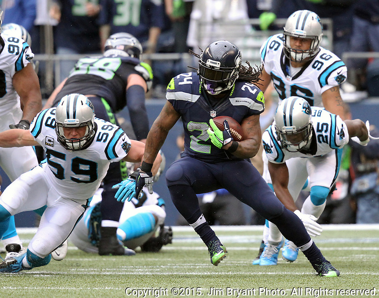 Seattle Seahawks  running back Marshawn Lynch (24) rushes against the Carolina Panthers  at CenturyLink Field in Seattle on October 18, 2015. The Panthers came from behind with 32 seconds remaining in the 4th Quarter to beat the Seahawks 27-23.  ©2015 Jim Bryant Photography. All Rights Reserved.