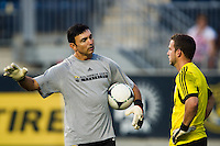 Columbus Crew goalkeeper coach Vojislav ?Scoop? Stanisic talks with goalkeeper Andy Gruenebaum (30) prior to playing the Philadelphia Union. The Columbus Crew defeated the Philadelphia Union 2-1 during a Major League Soccer (MLS) match at PPL Park in Chester, PA, on August 29, 2012.