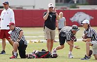 NWA Democrat-Gazette/DAVID GOTTSCHALK University of Arkansas Razorback head coach Chad Morris (center) watches drills Wednesday, August 8, 2018, during football practice on campus in Fayetteville.