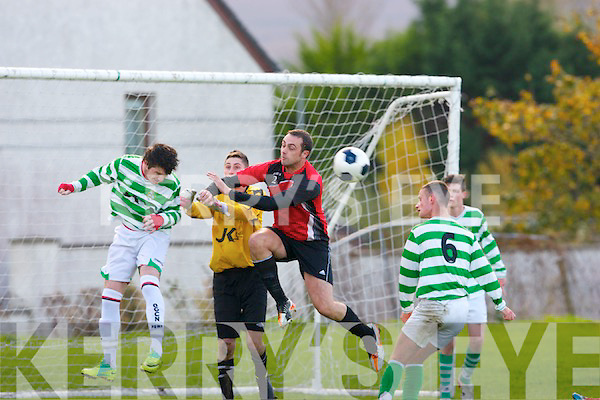 Paudie Quinn,Listowel Celtic heads the ball clear from a Park corner with Celtic keeper,Kevin Connor and  Martin Bowler Park also in flight when the sides met at Christy Leahy park,Mounthawk,Tralee last Sunday morning
