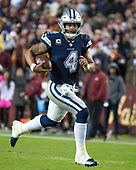 Dallas Cowboys quarterback Dak Prescott (4) scrambles for a first down late in the fourth quarter against the Washington Redskins at FedEx Field in Landover, Maryland on Sunday, October 21, 2018.  The Redskins won the game 20 - 17.<br /> Credit: Ron Sachs / CNP