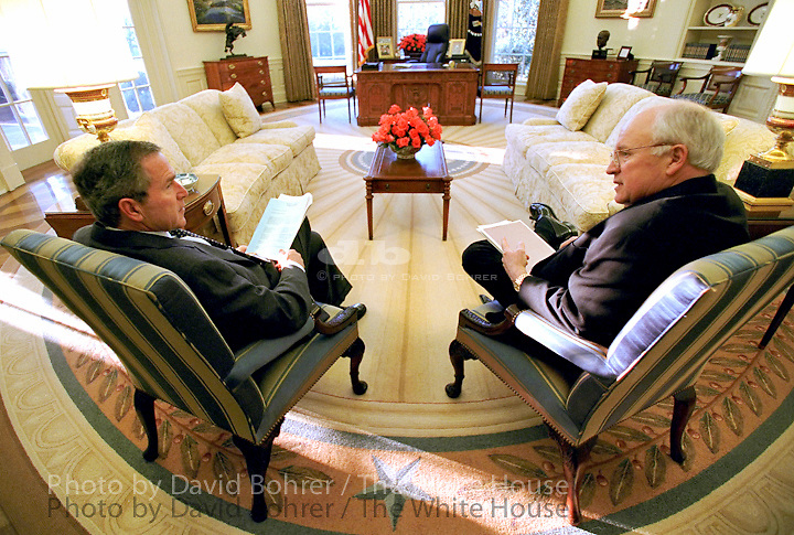 "President George W. Bush Vice President Dick Cheney talk together before their morning intelligence briefing, March 1, 2002, in the Oval Office. Printed in the Marine Corps University Foundation Program/ slide show  Released to: Grizzly Adams Productions 5.4.04    Released to: Randomhouse Publishing 6.22.07 Used for Photos of Note March 1 - 9, 2002.   PON Used in OVP  2002 Christmas Slide Show  WEB  WEST WING JUMBO  WEB. CROP. COLOR CORRECT..Released to Video Art Productions for the National Portrait Gallery exhibition, ""Presidents in Waiting."".2008 Christmas Slideshow"