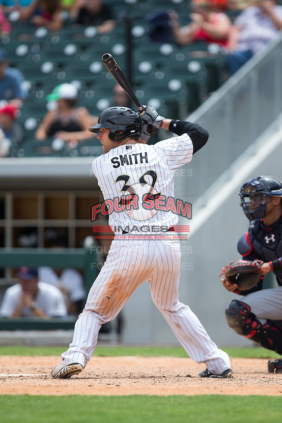 Kevan Smith (32) of the Charlotte Knights at bat against the Gwinnett Braves at BB&T BallPark on July 3, 2015 in Charlotte, North Carolina.  The Braves defeated the Knights 11-4 in game one of a day-night double header.  (Brian Westerholt/Four Seam Images)