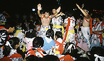 As the Nebuta Festival parade ends, dancers gather in the middle of the street in Aomori, Japan. Huge illuminated paper-mache floats made of lumber, bamboo, wire and paper depicting men, animals and birds are pushed and pulled through the streets by groups of men, women and children during the Nebuta Festival in Aomori, Japan.  The festival dates back to the beginning of the eight century when the Ezo residents in northern Honshu rose in revolt. The Emperor sent General Sakanoue-no-Tamramaro, who, built Nebuta dummies of men and horses which were floated away at night. The Ezo thinking the Imperial troops had withdrawn, came back into the city only to be slaughtered by troops waiting in secret. Themes of the floats are picked from Kabuki stages, historical characters or fairy tales. (Jim Bryant Photo).....