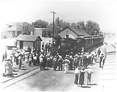 3/4 frontal view of train for &quot;The Texas Rangers&quot; movie at the Espanola depot with a large crowd.<br /> D&amp;RGW  Espanola, NM  1935