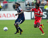 22 May 2010: New England Revolution midfielder Shalrie Joseph #21and Toronto FC forward Fuad Ibrahim #7 in action during a game between the New England Revolution and Toronto FC at BMO Field in Toronto..Toronto FC won 1-0.....