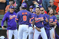 Second baseman Weston Wilson (8) of the Clemson Tigers is congratulated after scoring a run in the Reedy River Rivalry game against the South Carolina Gamecocks on Saturday, March 5, 2016, at Fluor Field at the West End in Greenville, South Carolina. Clemson won, 5-0. (Tom Priddy/Four Seam Images)