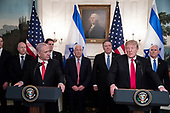 US President Donald J. Trump (Front R) delivers remarks beside Prime Minister of Israel Benjamin Netanyahu (Front L), before signing an order recognizing Golan Heights as Israeli territory, in the Diplomatic Reception Room of the White House in Washington, DC, USA, 25 March 2019.<br /> Credit: Michael Reynolds / Pool via CNP