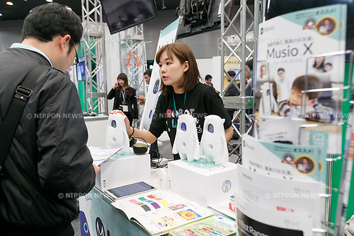 An exhibitor introduces to a visitor robot Musio X during SoftBank Robot World 2017 on November 21, 2017, Tokyo, Japan. SoftBank Robotics organized SoftBank Robot World 2017 to introduce AI (Artificial Intelligence) and IoT (the Internet of Things) companies developing the latest technology for robots, including applications its humanoid robot Pepper in various business fields. The robot expo runs until November 22. (Photo by Rodrigo Reyes Marin/AFLO)