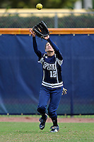 11 February 2012:  FIU's Erika Arcuri (12) prepares to catch a fly ball during pre-game drills as the University of Louisville Cardinals defeated the FIU Golden Panthers, 4-2, as part of the COMBAT Classic at the FIU Softball Complex in Miami, Florida.