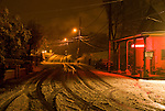 Snow covers the road and ground during a winter storm at night in Jackson Gate, Amador County, Calif.