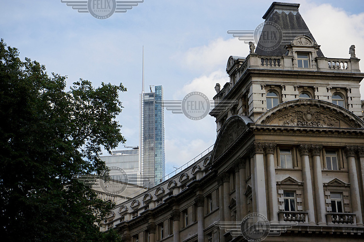 Heron Tower, 110 Bishopsgate, City of London, rises beyond a building in Finsbury Circus. Heron tower was, in 2012, London's second tallest building, rising 242 metres over 46 floors. It was completed in 2011and the architects were Kohn Pedersen Fox Associates.
