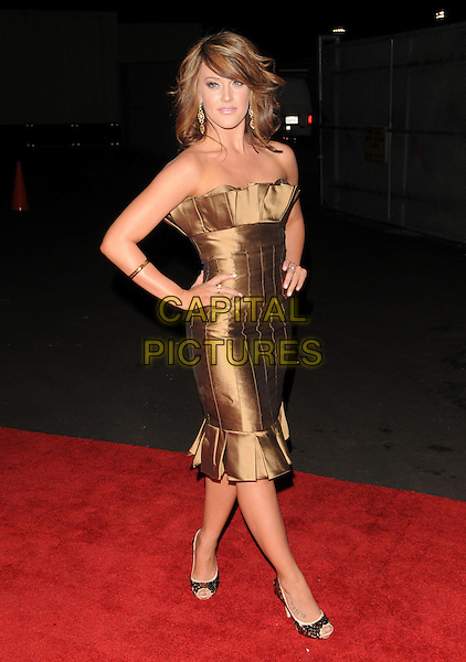LACEY-MAE SCHWIMMER .The Maxim's Hot 100 List Party held at Barker Hangar in Santa Monica, California, USA..May 13th, 2009.full length dress hands on hips brown gold strapless pleats pleated silk satin peep toe shoes .CAP/DVS.©Debbie VanStory/Capital Pictures.