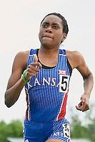 Malika Baker of Kansas competes in 1500 Meter final during Baylor Invitational track meet, Friday, April 03, 2015 in Waco, Tex. (Mo Khursheed/TFV Media via AP Images)