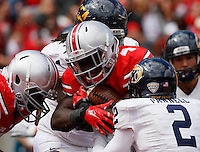 Ohio State Buckeyes running back Curtis Samuel (4) is tackled by Kent State Golden Flashes cornerback Malcolm Pannell (2) during Saturday's NCAA Division I football game at Ohio Stadium in Columbus on September 13, 2014. Ohio State won the game 66-0. (Dispatch Photo by Barbara J. Perenic)