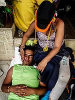 """Fatiga extrema y deshidratación presentan muchos de los migrantes que descansa en el comedor  y albergue Comunitario de la colonia San Luis de Hermosillo Sonora. <br /> <br />  Caravana del Migrante integrada por 600 personas en su mayoría de origen centroamericano, arribo a Hermosillo a bordo del tren conocido como """"La Bestia"""", provienen de la frontera Sur del País y con rumbo a la ciudad de Mexicali donde continuaran el viaje hasta Tijuana.<br /> La caravana tiene como objetivo solicitar <br /> asilo a Estados Unidos y algunos integrantes piensan solicitar una visa humanitaria en Mexico para laborar en los campos de Sonora y Baja California.<br /> (Photo: AP/Luis Gutierrez)"""
