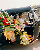 SRI LANKA, Asia, Galle, a hotel staff taking back flowers to the Amangalla Hotel.