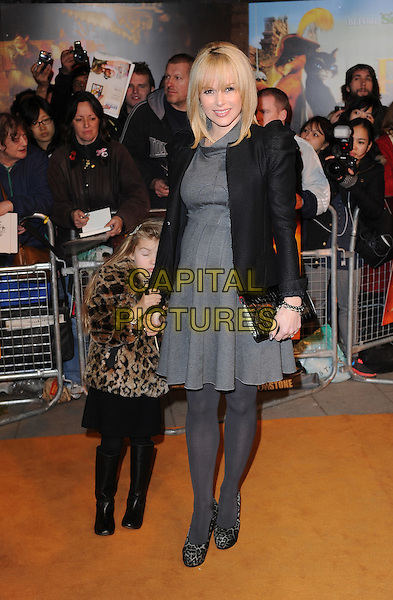 Amanda Holden & daughter Lexi.'Puss In Boots 3D' UK Premiere, Empire Leicester Square, London, England..24th November 2011.full length pregnant grey gray dress black jacket clutch bag puff shoulder sleeve family mother mum tights leopard print animal shoes shy hiding .CAP/BEL.©Tom Belcher/Capital Pictures.