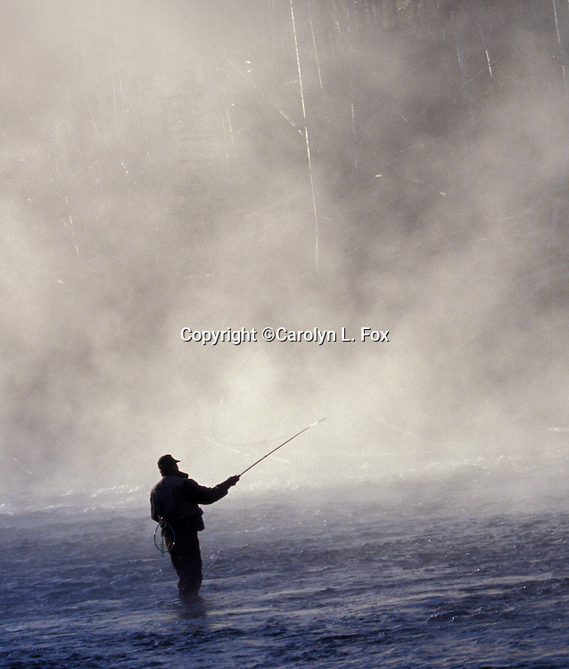 A man fishes in Yellowstone.