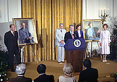 United States President Jimmy Carter makes remarks at the unveiling of the portraits of former US President Gerald R. Ford and first lady Betty Ford in the East Room of the White House in Washington, DC on August 4, 1980. The paintings will be on permanent display at the White House along with those of other US Presidents and first ladys.  From left to right: President Ford; Nash Castro, Vice Chairman, White House Historical Association; President Carter; first lady Rosalynn Carter; and former first lady Betty Ford.<br /> Credit: Benjamin E. &quot;Gene&quot; Forte / CNP