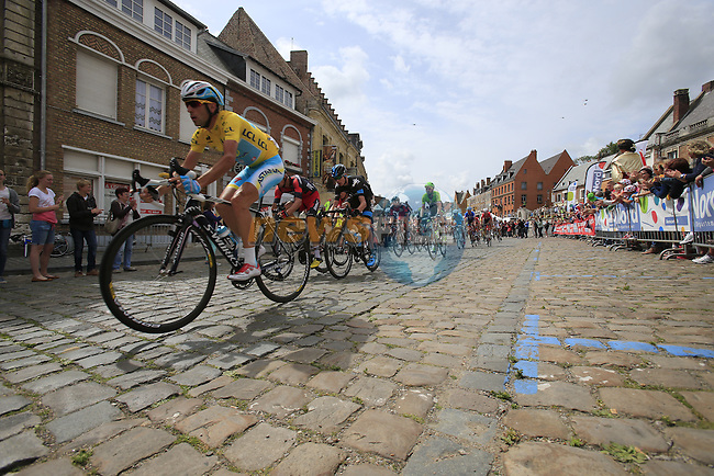 The peleton including Yellow Jersey leader Vincenzo Nibali (ITA) Astana pass through the ancient town of Cassel during Stage 4 of the 2014 Tour de France running 163.5km from Le Touquet to Lille. 8th July 2014.<br /> Picture: Eoin Clarke www.newsfile.ie