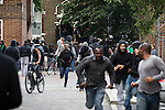 © Joel Goodman - 07973 332324 . 08/08/2011 . London , UK . People run through streets on the Pembury Estate in Hackney during a 3rd night of rioting and looting in London , which followed a protest against the police shooting of Mark Duggan in Tottenham . Photo credit : Joel Goodman