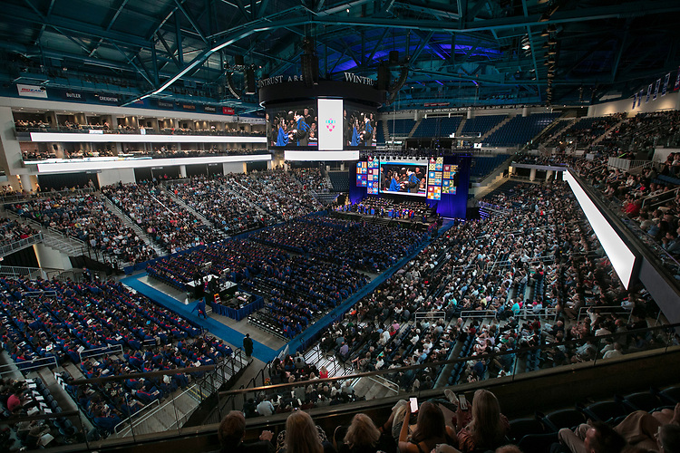 Friends and family join DePaul graduates inside Wintrust Arena, Sunday, June 10, 2018, for the Driehaus College of Business commencement ceremony. Approximately 6,700 students graduated during five ceremonies held over the weekend. (DePaul University/Jamie Moncrief)