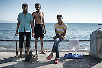 Group of Pakistani friends hoping for a better life in Europe. They wait for their papers at the seaside drying their clothes. Kos, Greece. Sept. 6, 2015