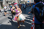 A marathoner waves to the crowed during the Tokyo Marathon on Sunday, Feb. 26, 2017 in Tokyo, Japan.<br /> Photo by Kevin Clifford
