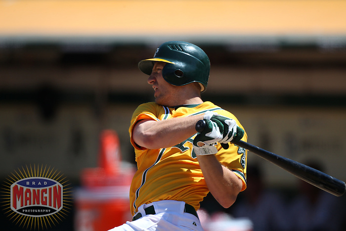 OAKLAND, CA - JULY 6:  Cliff Pennington #2 of the Oakland Athletics bats against the Seattle Mariners during the game at the Oakland-Alameda County Coliseum on July 6, 2011 in Oakland, California. Photo by Brad Mangin