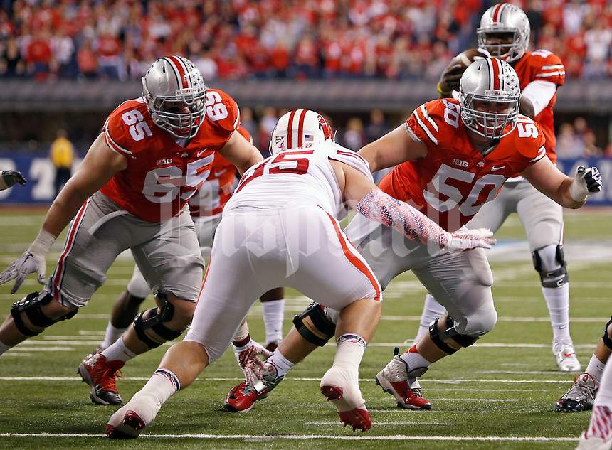 Ohio State Buckeyes offensive lineman Pat Elflein (65) and Ohio State Buckeyes offensive lineman Jacoby Boren (50) against Wisconsin Badgers in the 2014 Big Ten Football Championship Game at Lucas Oil Stadium in Indianapolis, Ind. on December 6, 2014.  (Dispatch photo by Kyle Robertson)