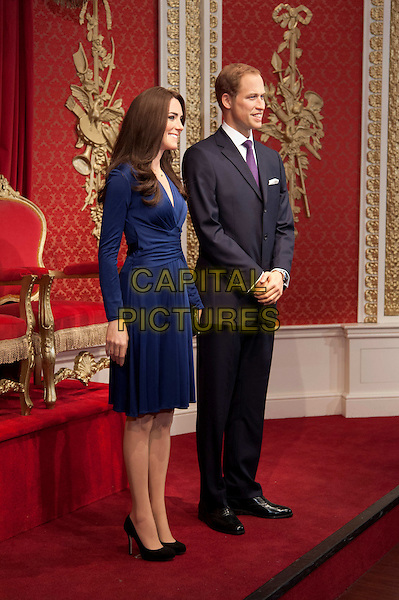 Prince William, Duke of Cambridge and Kate, Duchess of Cambridge waxwork unveiling at Madame Tussauds.  Waxworks of the Royal couple are revealed to celebrate their first wedding anniversary, joining the rest of the Royal line-up already immortalised at the attraction. London, England..April 4th, 2012.Catherine waxwork full length dress profile blue black suit .CAP/BF.©Bob Fidgeon/Capital Pictures.