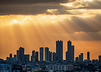 Sunset and sun-rays over Makati skyline, Manila, Philippines
