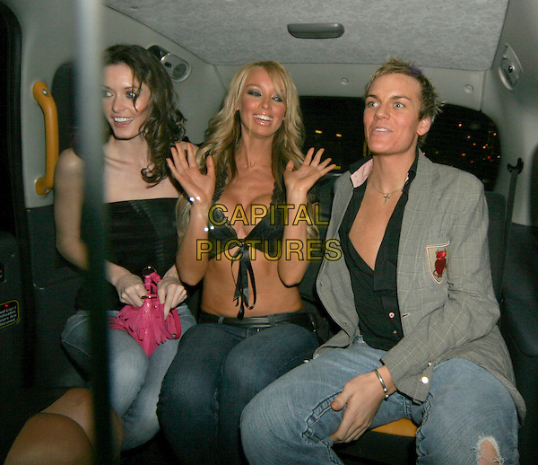 LAUREN POPE.At Mint, London, UK..January 17th, 2006.Ref: SW.half length black cleavage top car cab sitting.www.capitalpictures.com.sales@capitalpictures.com.©Capital Pictures.