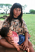 Rio Grande do Sul, Brazil. Guarani Indian mother with her daughter asleep on her lap.