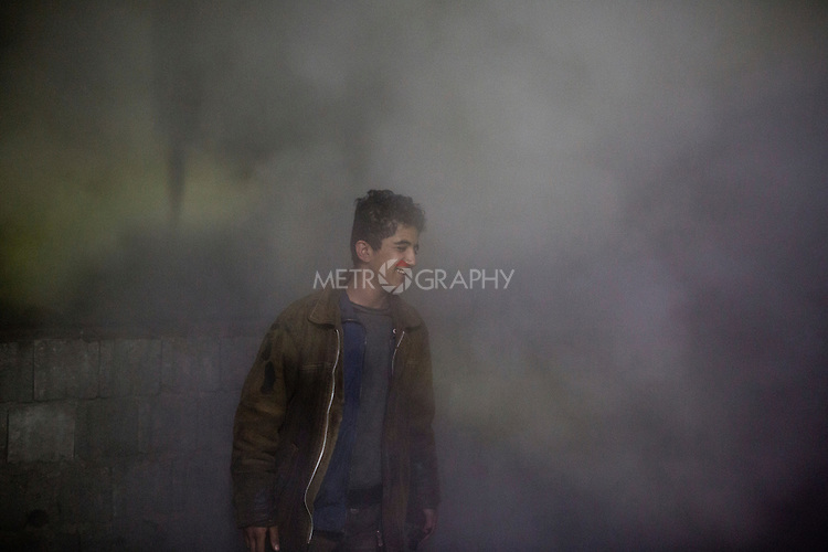 19/02/15 --TANJERO, IRAQ: Jamal (17) walks through steam at the refinery.<br /> <br /> The family of Yezidis, displaced from Sinjar, live next to an oil refinery in the Kurdish Region of Iraq. The young men run the refinery 24 hours a day with little to no safety equipment. Reporting for this article was supported by a grant from the Pulitzer Center on Crisis Reporting