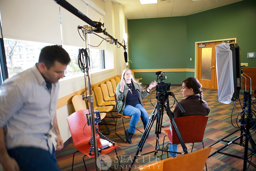 04112012-  Seattle University Albers grad students work on film interviews for the Red Winged Leadership Award finalist Recovery Cafe - Killian Noe.