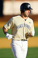 Carlos Lopez #3 of the Wake Forest Demon Deacons rounds the bases after hitting a 2-run home run in the bottom of the first inning against the Georgetown Hoyas at Wake Forest Baseball Park on February 26, 2012 in Winston-Salem, North Carolina.  (Brian Westerholt / Four Seam Images)