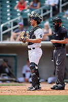 Birmingham Barons catcher Seby Zavala (19) in front of home plate umpire Reid Joyner during a game against the Pensacola Blue Wahoos on May 9, 2018 at Regions FIeld in Birmingham, Alabama.  Birmingham defeated Pensacola 16-3.  (Mike Janes/Four Seam Images)