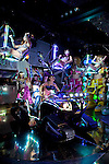 December 20, 2012, Tokyo, Japan - The Robot Restaurant show of electric lights, tanks and giant robots controlled by bikini clad women is held twice a day in Kabukicho, Shinjuku one of the most famous entertainment districts in Tokyo. The 4000 Yen entrance fee covers the food, one drink, service charge and the show itself. The show introduced the giant new King Robota with three mad professors to control it and the already famous giant female robots controlled by the performers. The bizarre current show includes taiko drums, a traditional festival float, Gangnam Style dancing, bikes, Segways, a tank, a plane and a marching band. Audience members are given light sticks to wave as the performers dance and fly around the room above them. The crazy show is gaining in popularity in Japan and worldwide and has featured on Japanese TV and in some guidebooks. During the set changes the audience can shoot pictures with the robots and have a chance to ride on some of them too. Built at a cost of 10 Billion Yen (around USD 127 million), the Robot Restaurant opened in Kabukicho on July 18, 2012, and now attracts customers from all over the world. (Photo by Rodrigo Reyes Marin/Nippon News)