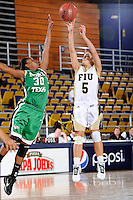 6 February 2010:  FIU's Michelle Gonzalez (5) shoots a jump shot over North Texas' Brittney James (30) in the second half as the FIU Golden Panthers defeated the North Texas Mean Green, 72-55, at the U.S. Century Bank Arena in Miami, Florida.