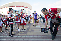SARANSK, RUSSIA - June 25, 2018: An Iran fan takes video of some Russian folk artists in Millennium Square in Saransk before the 2018 FIFA World Cup group stage match between Iran and Portugal at Mordovia Arena.