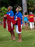 Two local people holding leis which will be placed on King Kamehameha statue, King Kamehameha Day Parade, North Kohala, Kapa'au town.