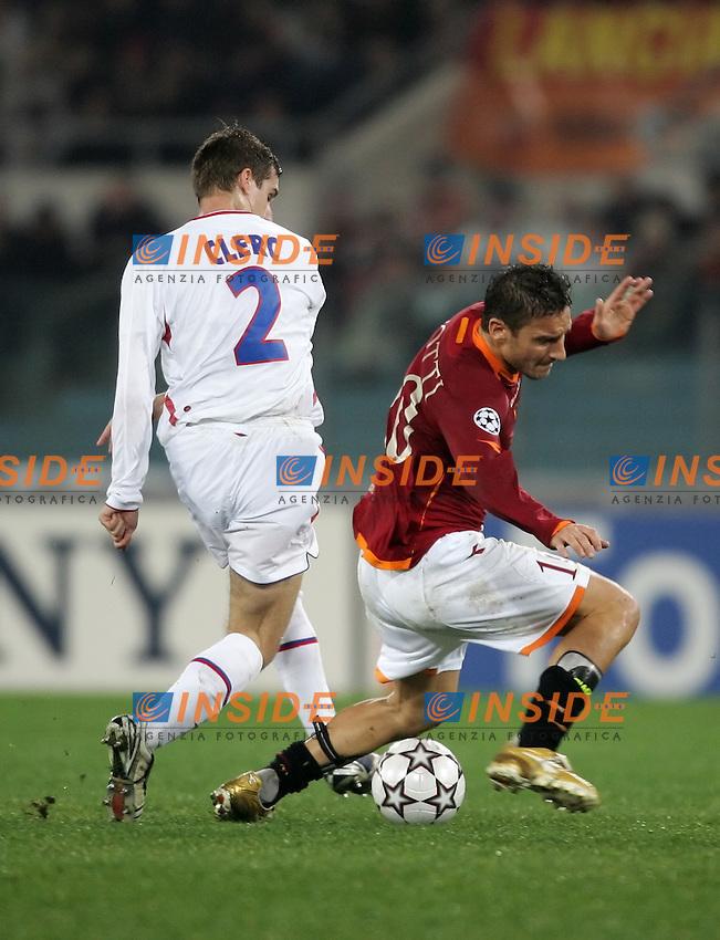Francois Clerc (Olympique Lyonnais), Francesco Totti (Roma)<br /> Champions League 2006-2007<br /> 21 Feb 2007 (First knockout round)<br /> Roma - Olympique Lyonnaise (0-0)<br /> &quot;Olimpico&quot; Stadium - Roma - Italy<br /> Photographer: Andrea Staccioli Inside Roma Olympique Lyon