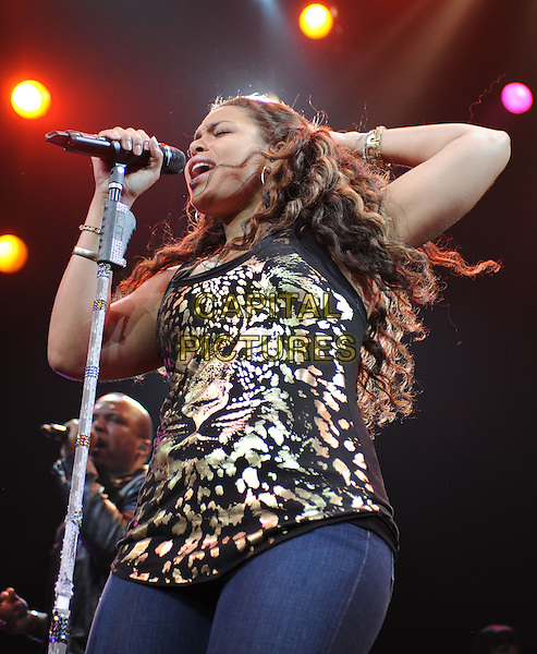 JORDIN SPARKS .performs live during The Battlefield Tour held at The Grove of Anaheim in Anaheim, California, USA, .July 2nd 2010..half length  music on stage in concert gig                                                                               black gold print vest top jeans microphone singing .CAP/RKE/DVS.©DVS/RockinExposures/Capital Pictures.