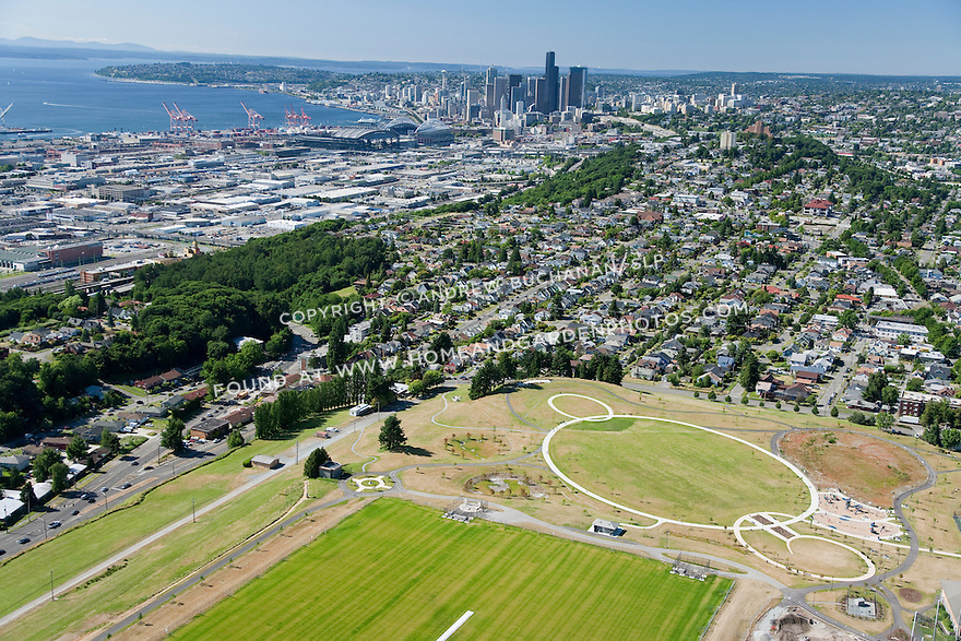 aerial photo of Jefferson Park, former site of two urban reservoirs on Seattle's Beacon Hill, the larger of the two is now buried underground and lidded (rectangular, in foreground) for security, and topped with sports playfields; Seattle, WA; July, 2011
