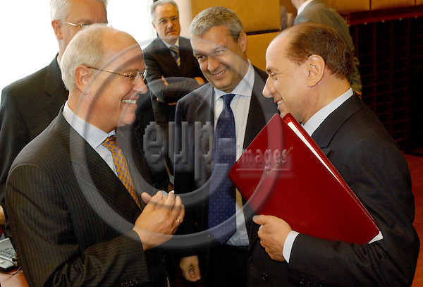 Brussels-Belgium - July 05, 2004---Meeting of the 'EUROGROUP'  at the 'Justus Lipsius', seat of the Council of the European Union in Brussels; here, Gerrit ZALM (le), as Dutch Deputy Prime Minister and Minister of Finance also acting President of ECOFIN, with Silvio BERLUSCONI (ri), Italian Prime Minister and representing/replacing his Minister of Finance (Giulio Tremonti resigned/has been dismissed on the eve of the meeting)---Photo: Horst Wagner/eup-images